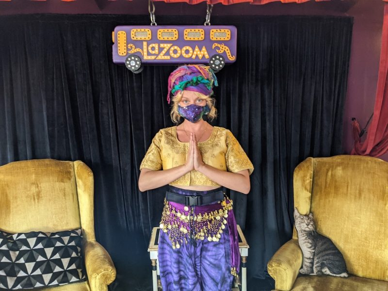 Tour Guide in LaZoom Room wearing a mask.